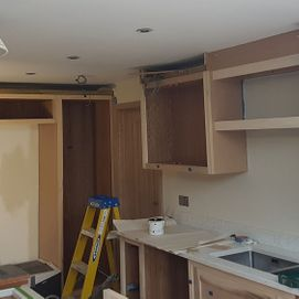 a customers kitchen being painted